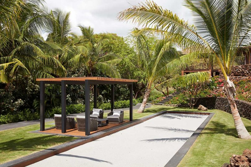 tropical yard with covered seating area
