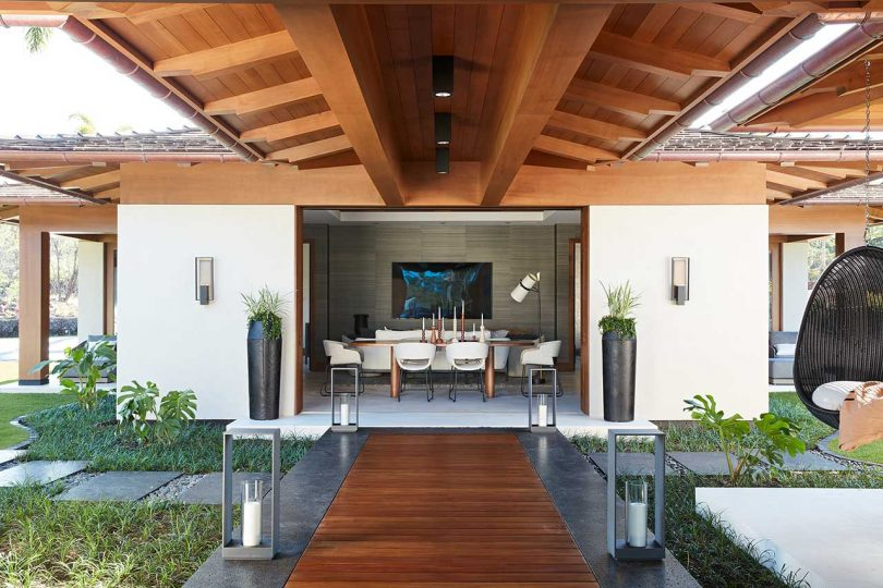 covered walkway view into space with dining table