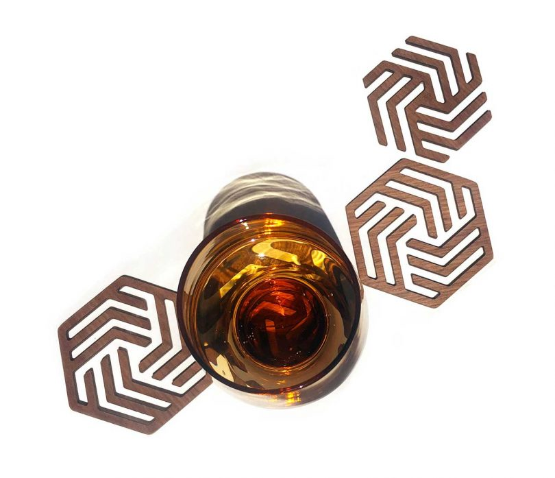 geometric wooden coasters with a glass
