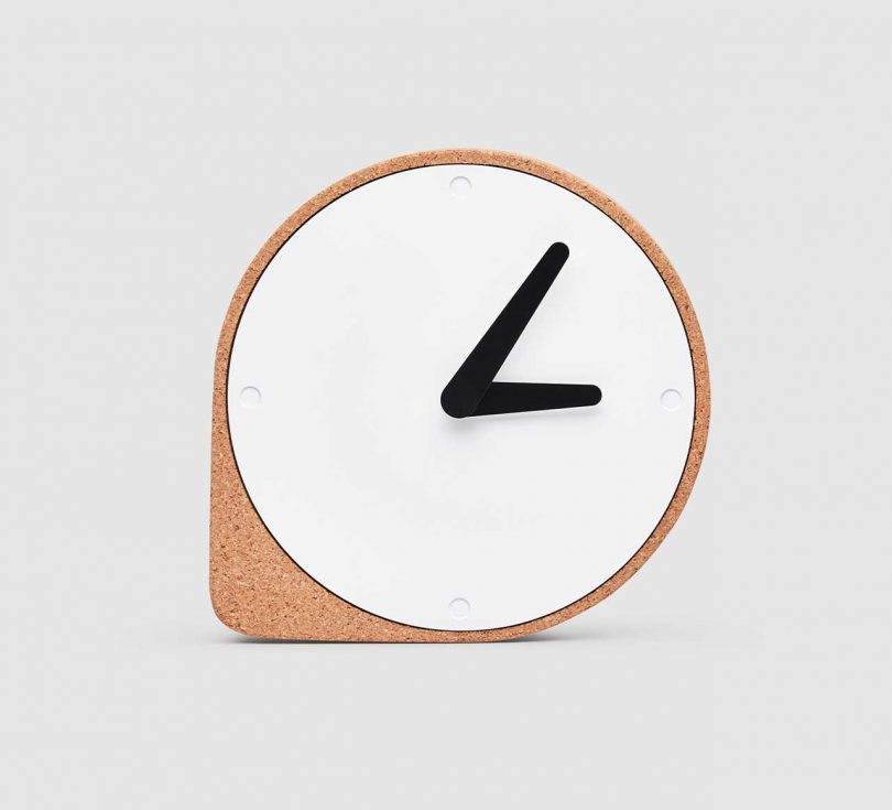 modern cork clock with white metal face and black hands
