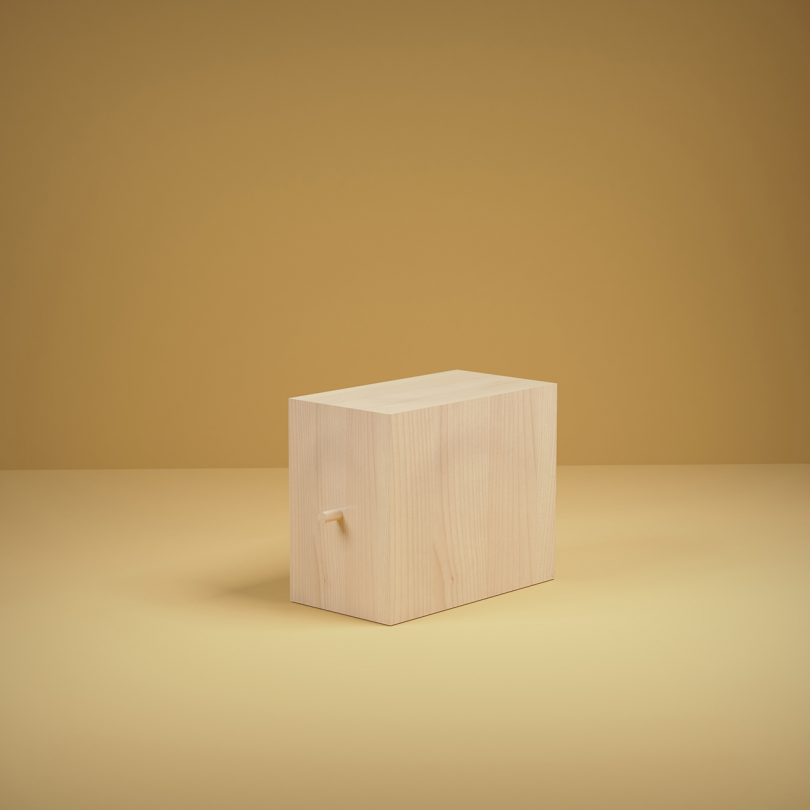 unfinished wood box on golden yellow background