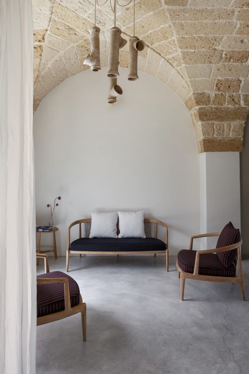 outdoor loveseat and armchair in a space with light colored walls
