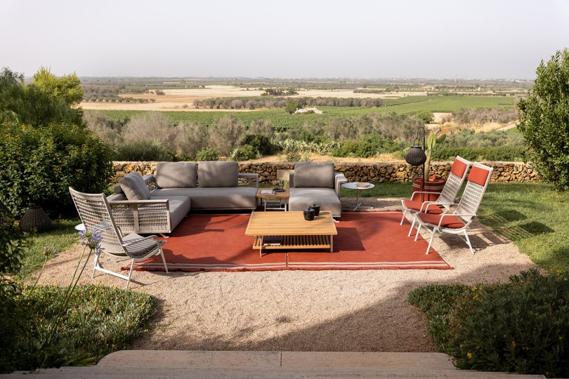 outdoor furniture on a patio overlooking the countryside