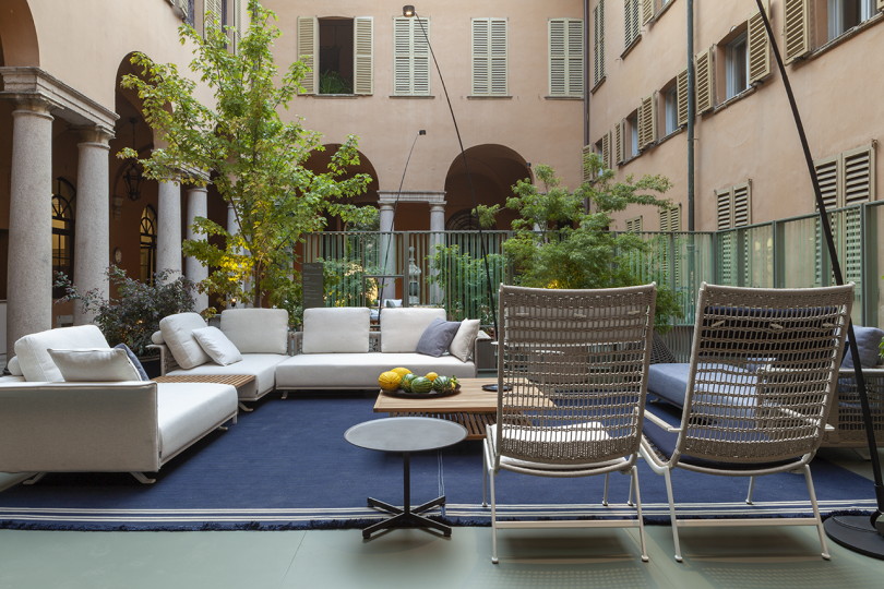 interior courtyard with outdoor furniture and trees