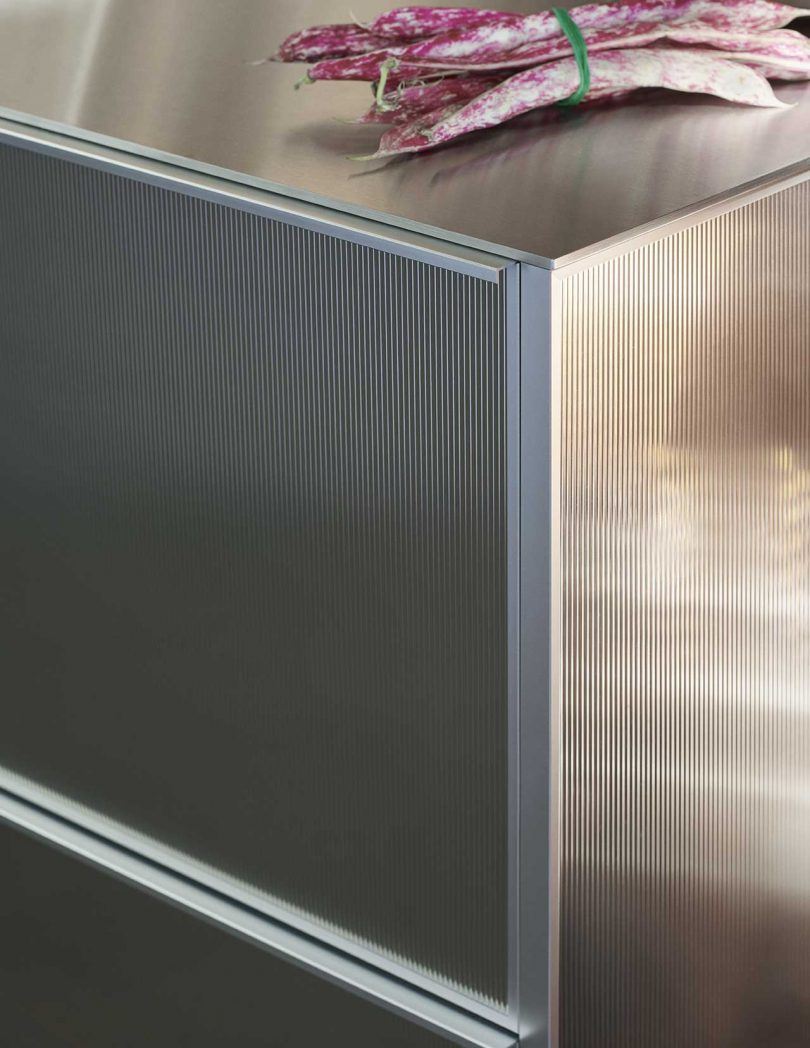 corner of reflective kitchen cabinets