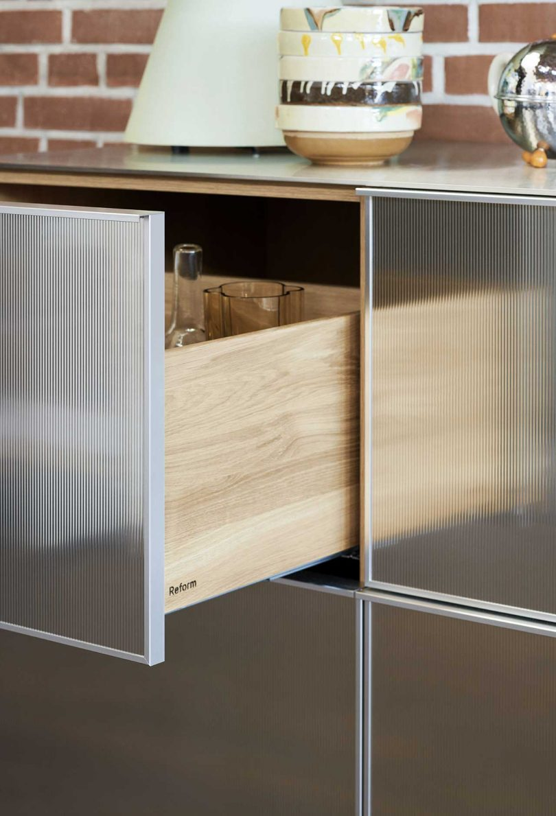reflective kitchen cabinets with drawer open