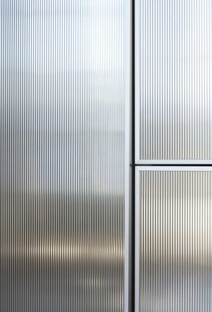 surface of reflective kitchen cabinet doors