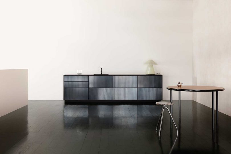 reflective black kitchen cabinets in apartment