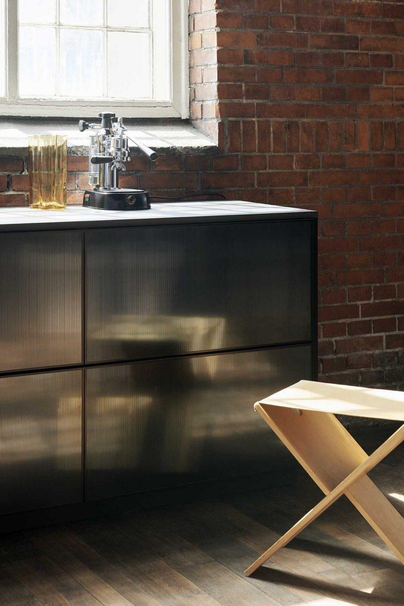 reflective black kitchen cabinets