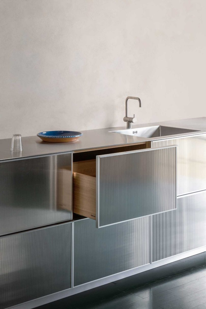 reflective lower kitchen cabinets with drawer open