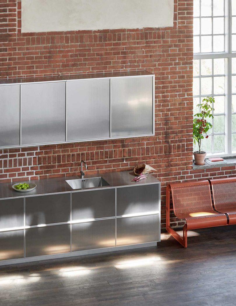 reflective kitchen cabinets in loft