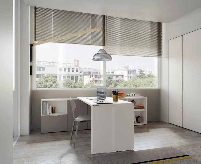 interior room with low shelf acting as a desk in front of window