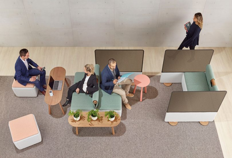 four individuals interacting with a versatile office layout