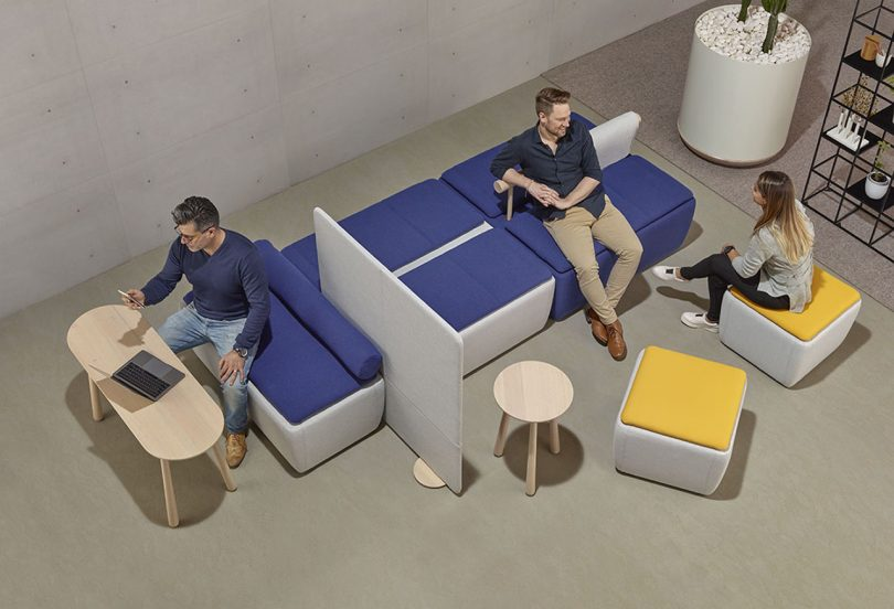 three individuals interacting with a versatile office layout