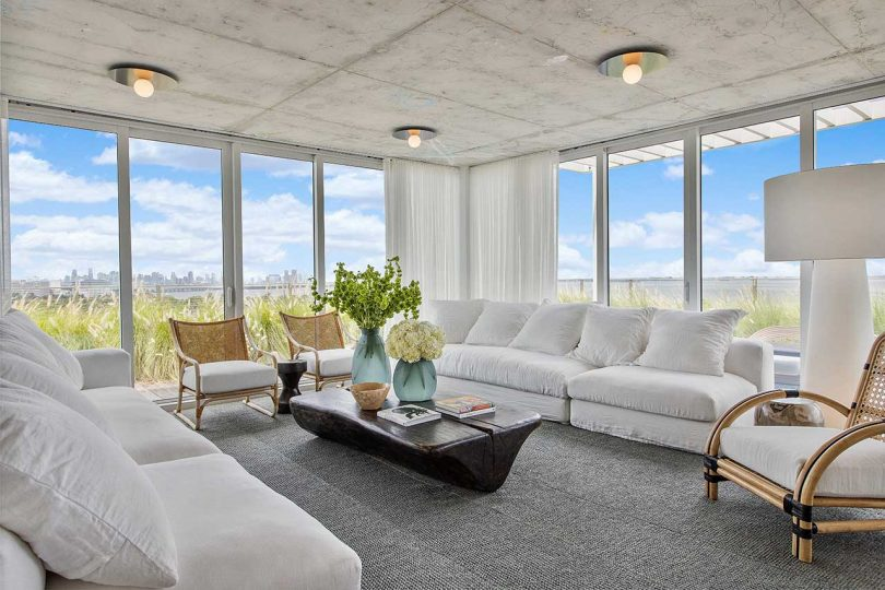 modern living room overlooking city with white sofas