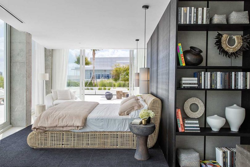 modern bedroom and open bathroom looking out to the rooftop terrace