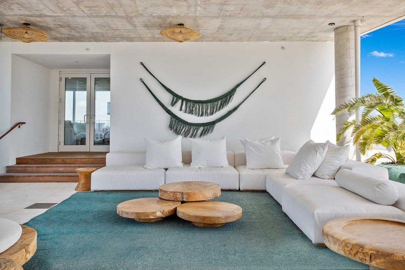 covered terrace with white sofa and green carpet