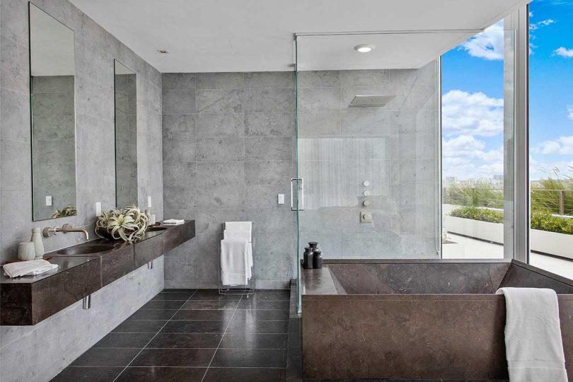 modern bathroom in wood and gray tones