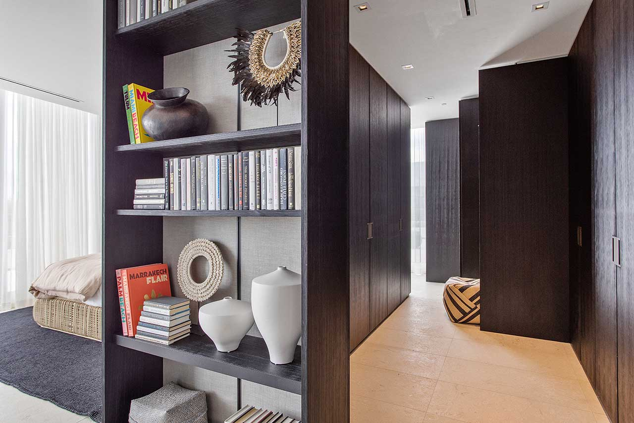modern shelf and closet in main bedroom