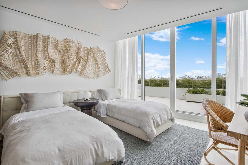 modern bedroom with twin beds in light, natural tones