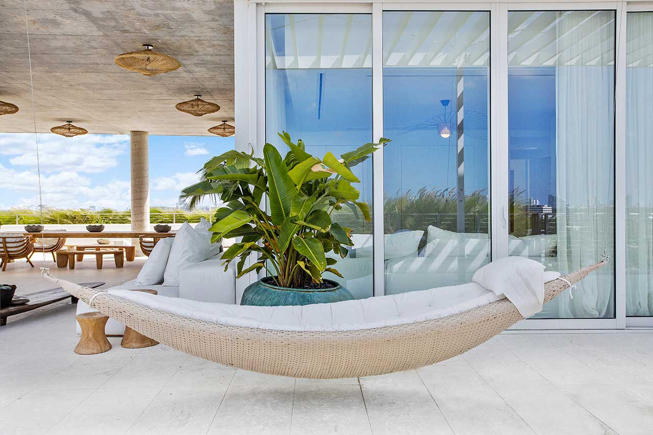 outdoor patio on rooftop with hammock