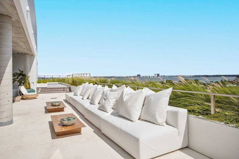 penthouse patio with white sofa overlooking city
