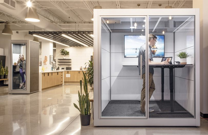 workspace pod in work environment with one person inside