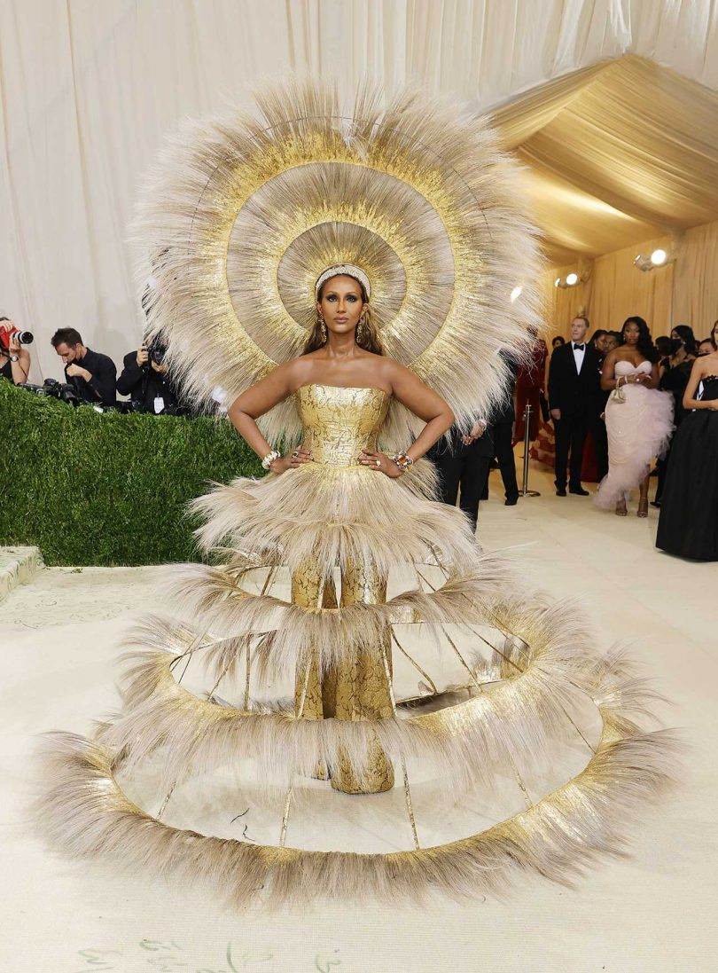 model Iman dressed in gold and feathers at Met Gala
