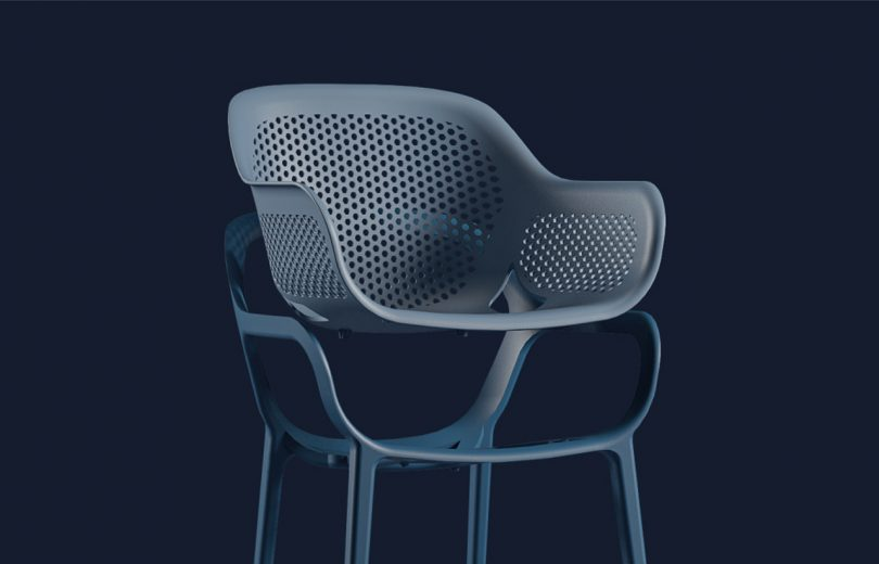 dissected dark colored outdoor armchair on black background