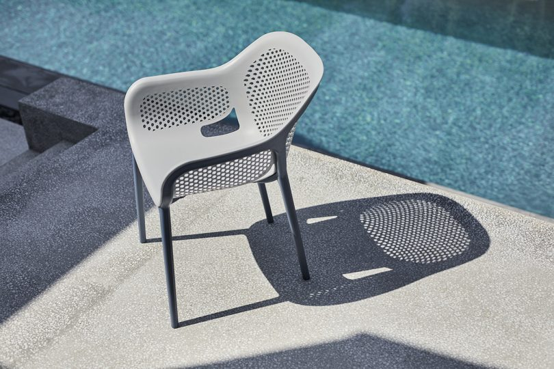 outdoor armchair next to pool