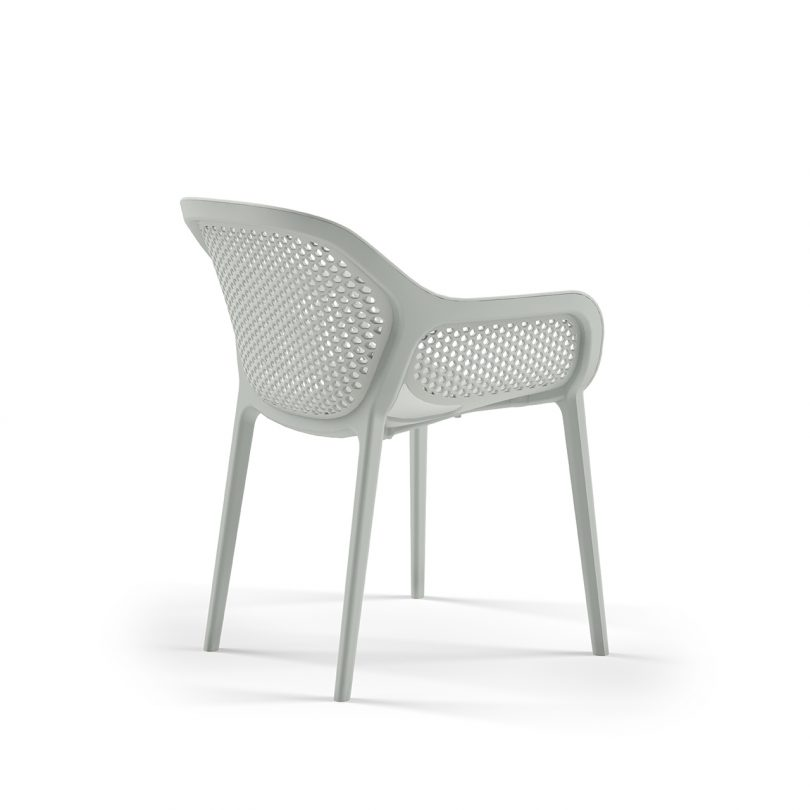 three quarter photo of light colored outdoor armchair on white background