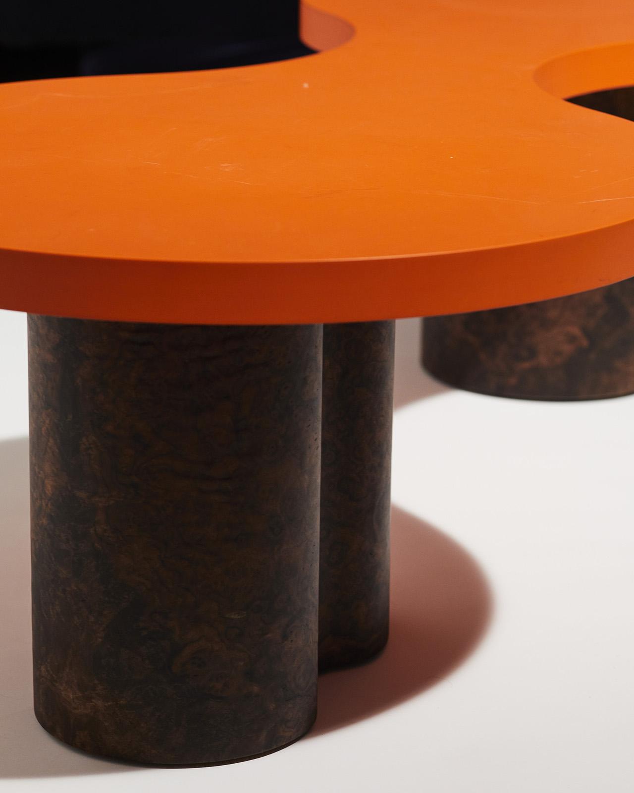 coffee table detail of orange top and dark wood legs