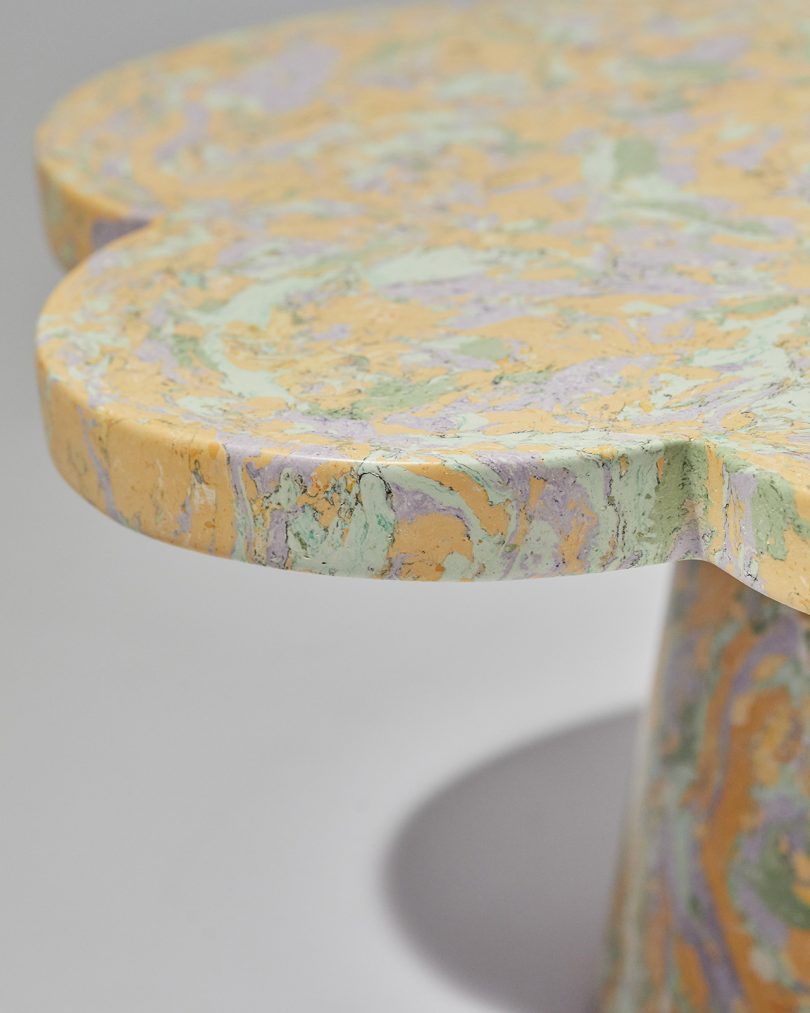 detail of pastel marbled table with petal shaped top