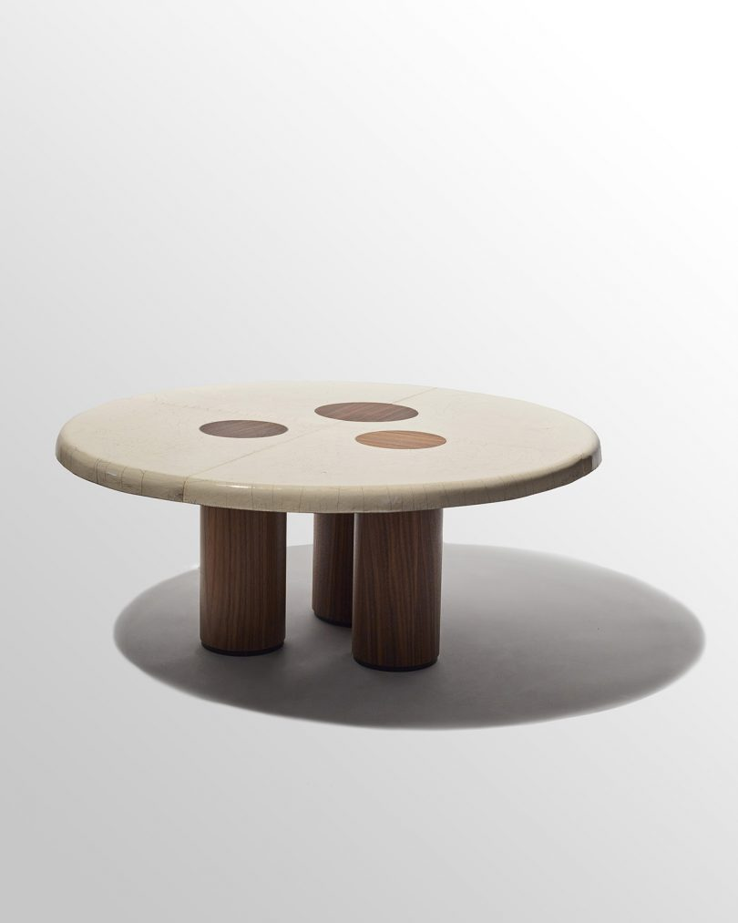 low wooden table with cylindrical legs