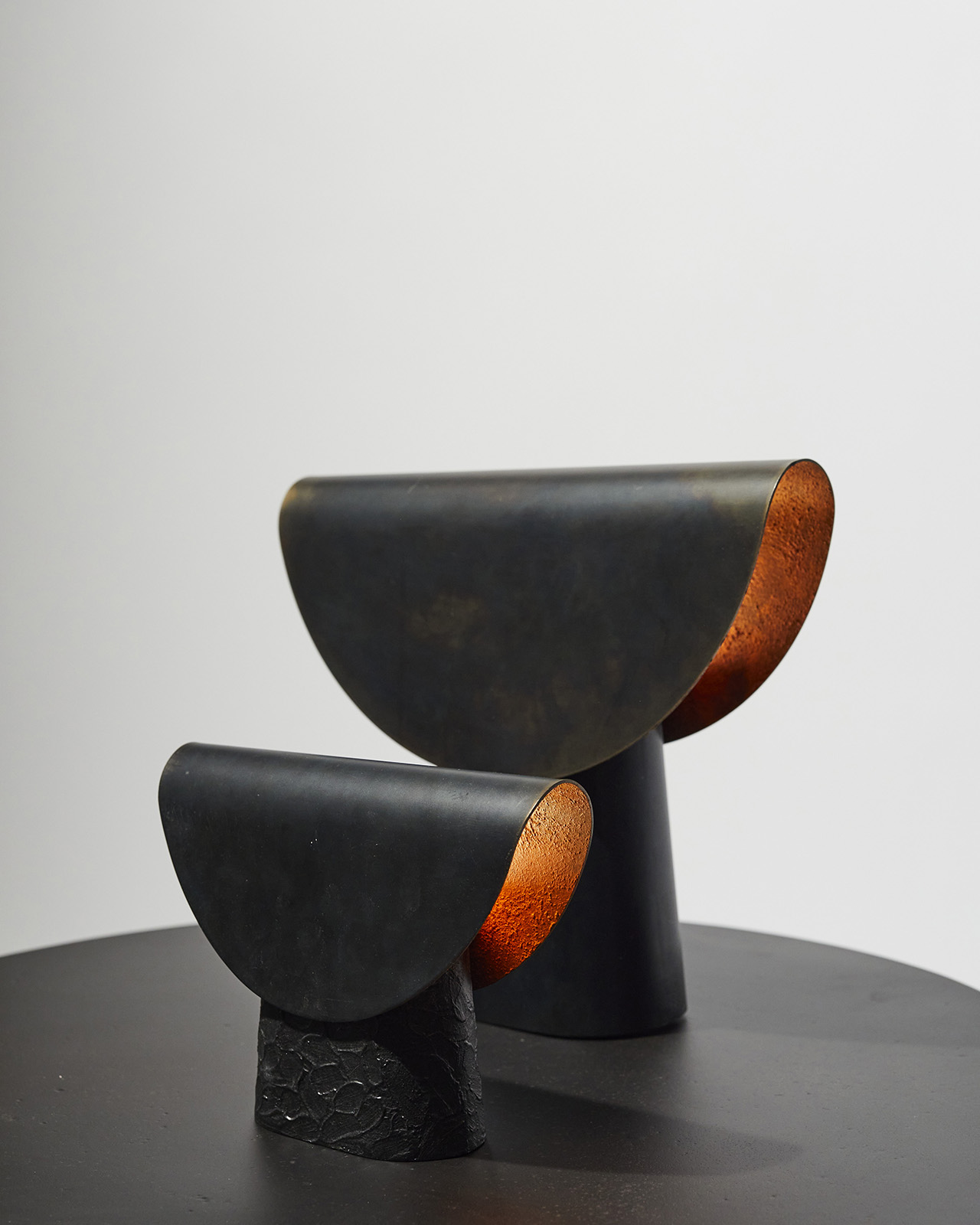 two black lamps of varying sizes