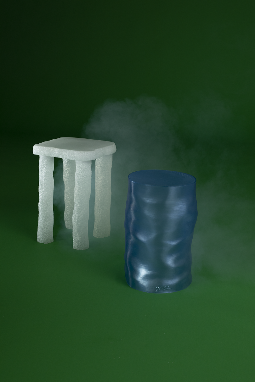 white side table and blue stool on green background