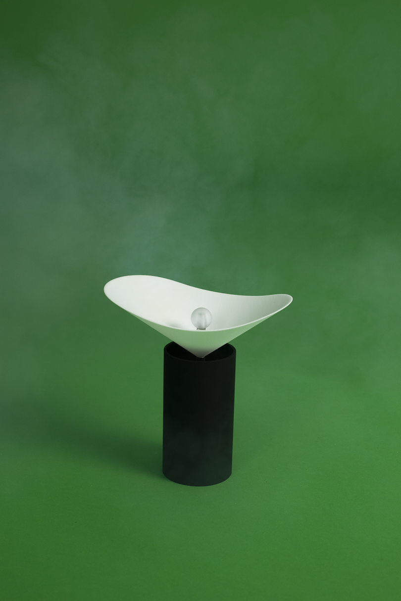 black and white lamp on green background