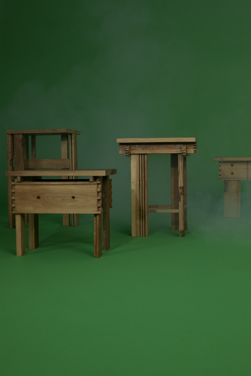 a group of wood tables on green background