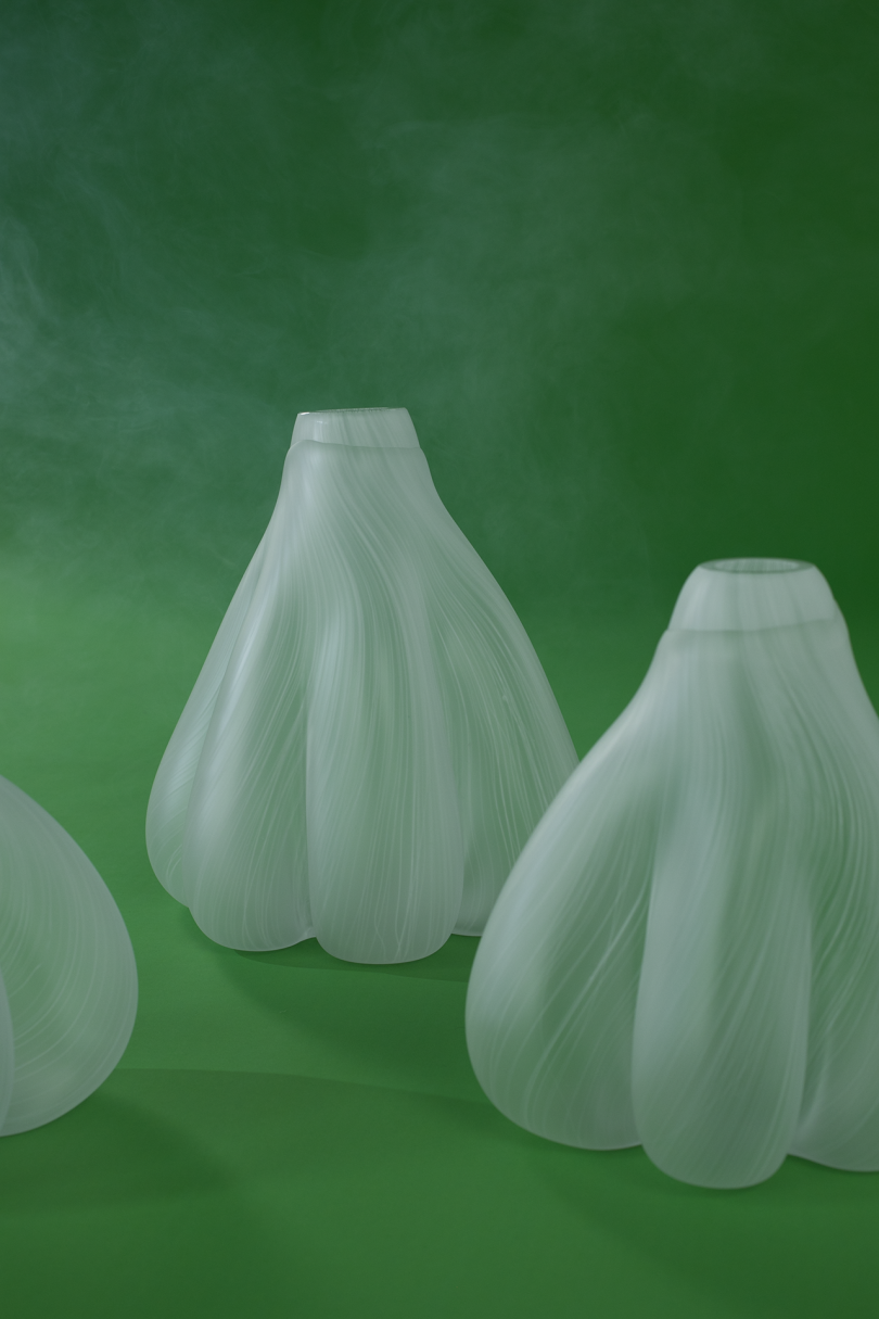 abstract white objects on green background