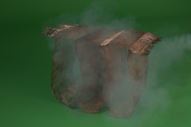woven object on dark green background with white smoke