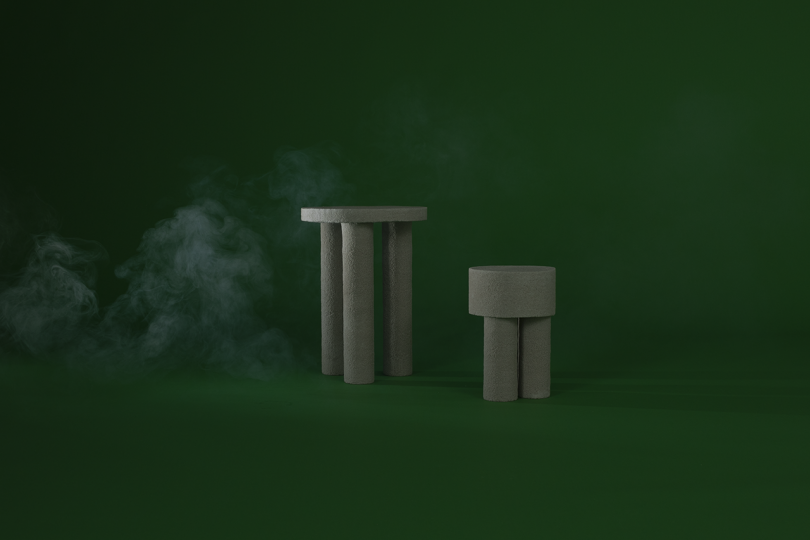 two light grey tables on dark green background with white smoke