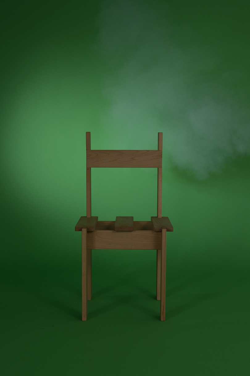 dining chair on dark green background with white smoke