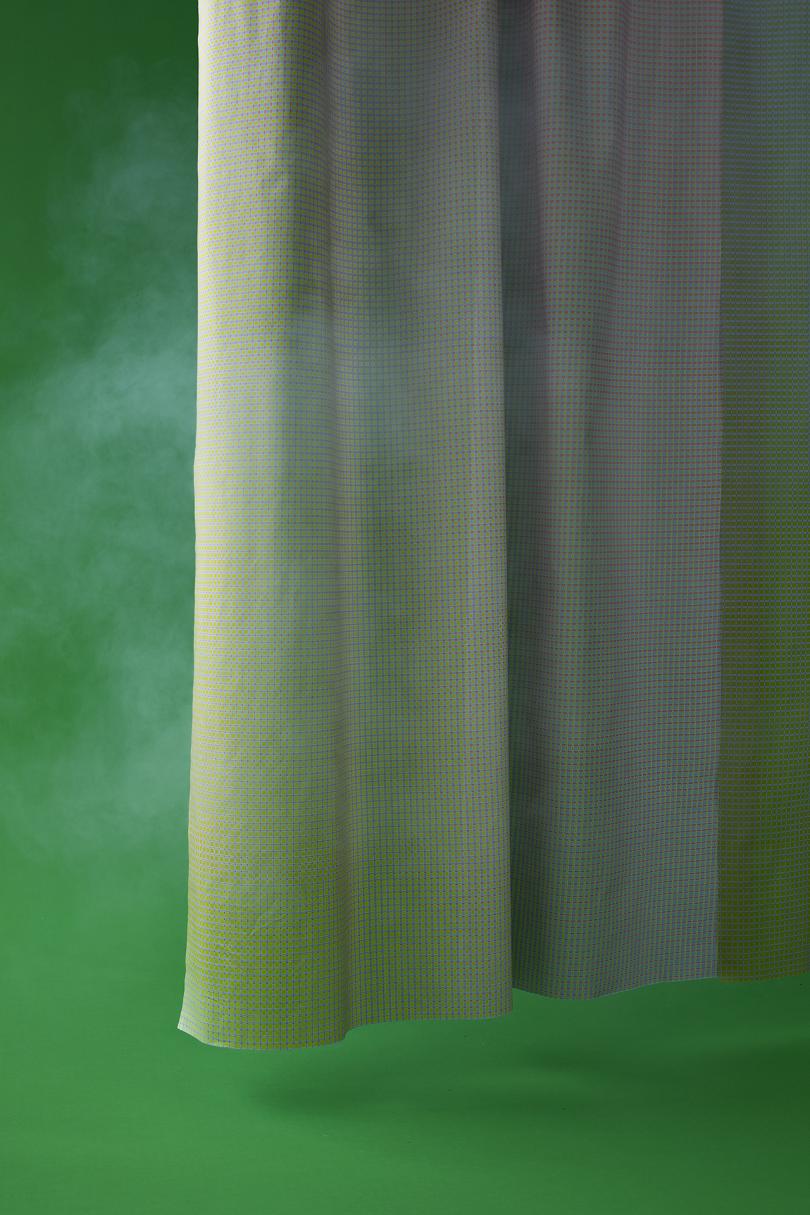 grey curtain on dark green background with white smoke