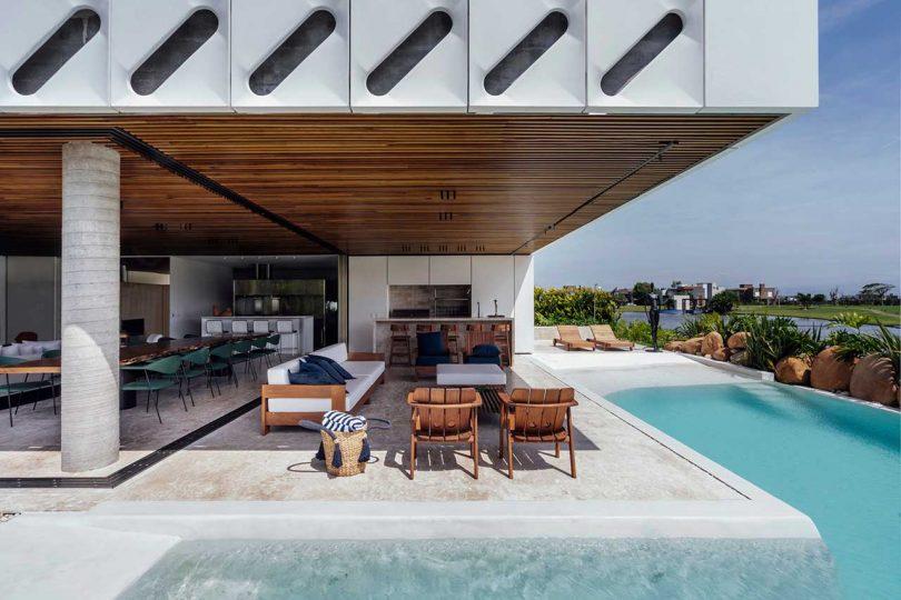 view under modern house open to backyard pool via sliding glass doors
