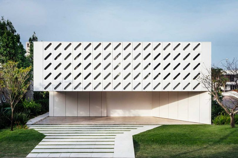modern white house with diagonally slotted facade