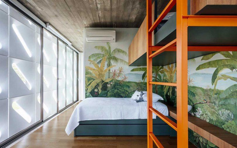 bunk beds in bedroom with tropical mural