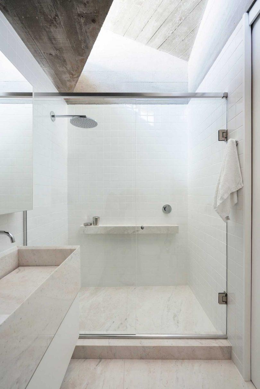 light-filled white bathroom in modern house