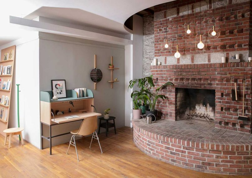 office with small desk and curved fireplace