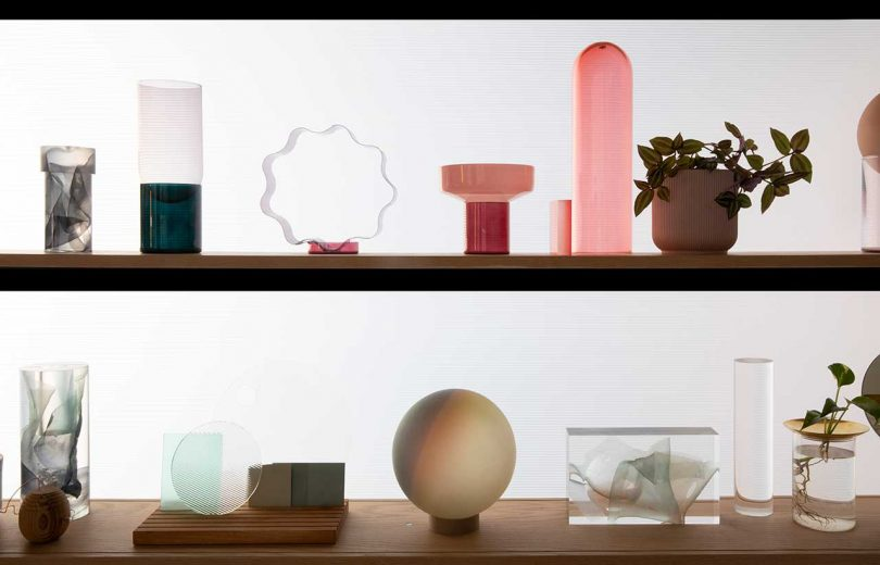 two lit shelves with design objects