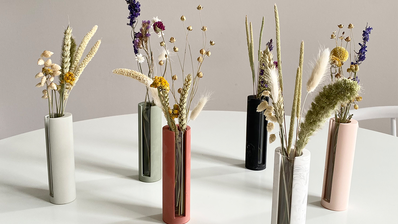 house raccoon propagation stations with dried flowers in them on a white table